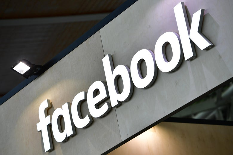 The Facebook logo is displayed on a sign.