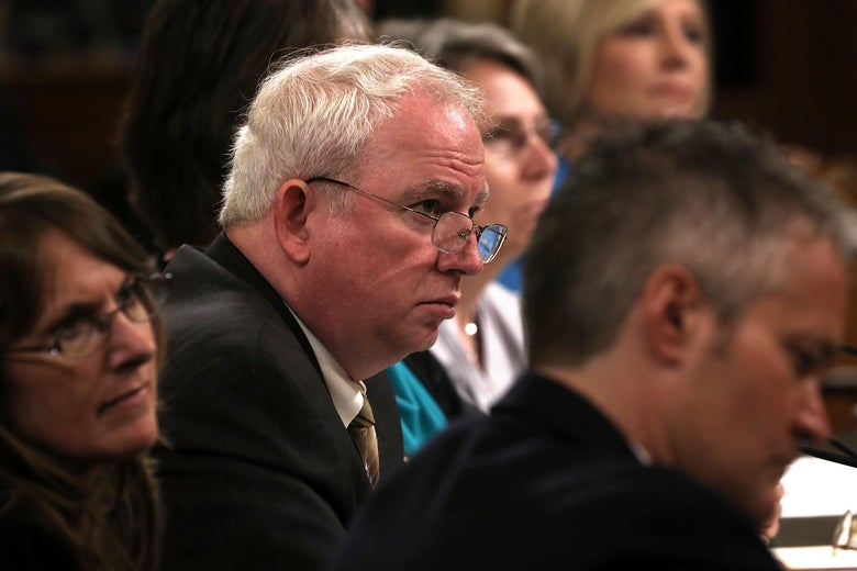 John Eastman looks very serious while seated on a panel testifying before Congress.