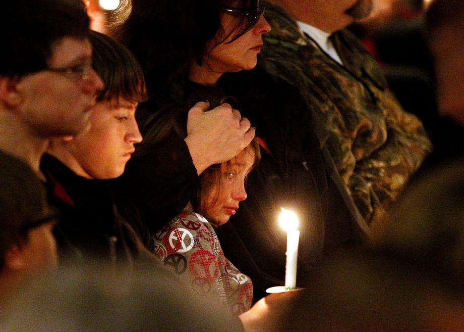 The people of West, Texas, during a candlelight vigil on Thursday, April 18, 2013, for victims, families, friends and first responders near the scene of the fertilizer plant that exploded Wednesday night.