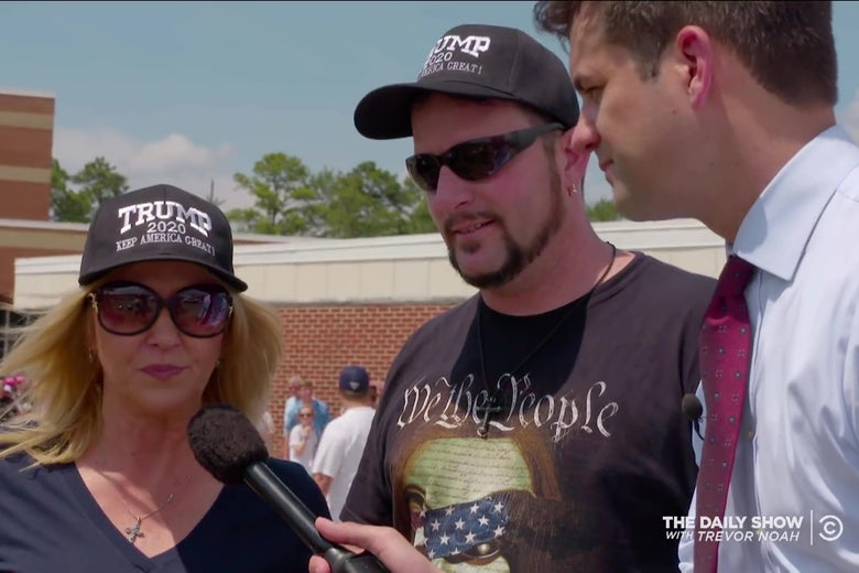 Michael Kosta interviewing two Trump supporters.