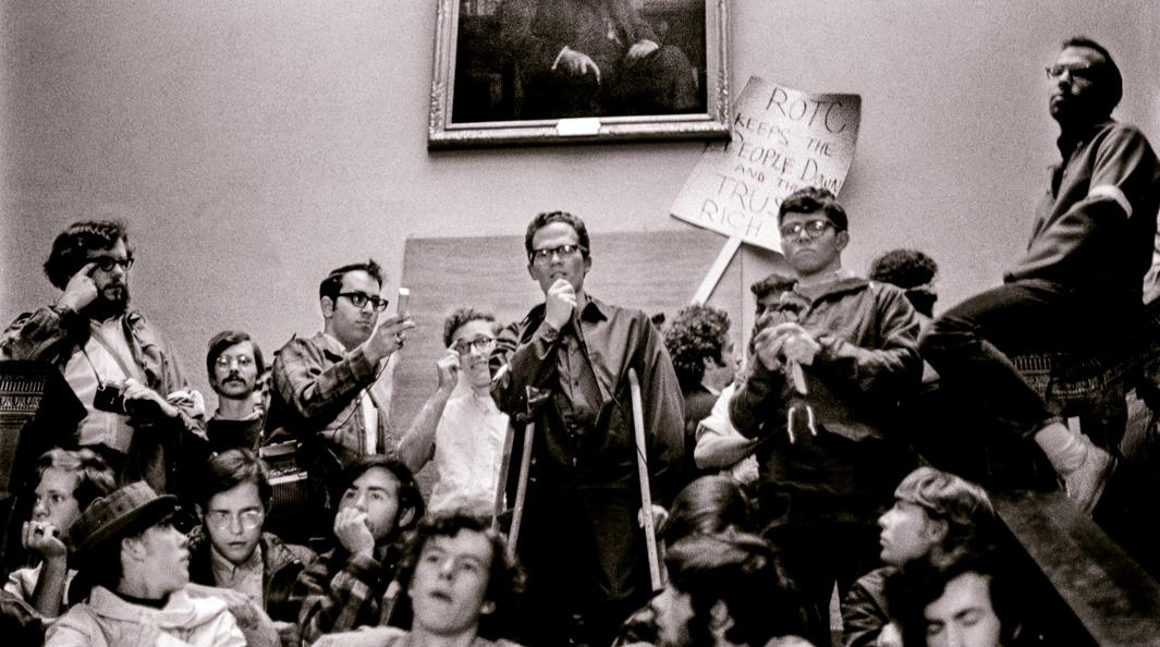 Young professor supports demonstrators outside college president's office, Hanover, New Hampshire, Spring 1969.