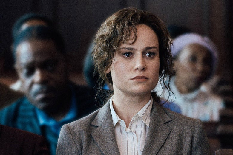 Brie Larson staring intensely with curls of hair dripping down her face