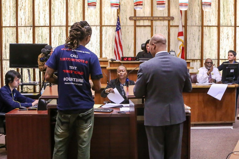 A man who has never been eligible to vote is called up during a special court hearing aimed at restoring the right to vote under Florida's Amendment 4 in a Miami-Dade County courtroom in November.