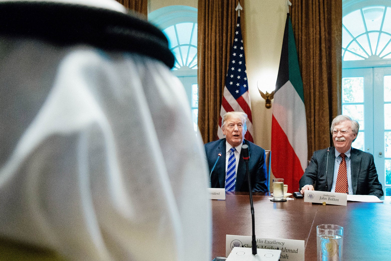 President Donald Trump and National Security Adviser John Bolton sit across the table from the Emir of Kuwait Jaber Al-Ahmad Al-Sabah.