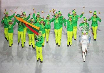 Figure skater Deividas Stagniunas of the Lithuania Olympic team carries his country's flag during the Opening Ceremony of the Sochi 2014 Winter Olympics at Fisht Olympic Stadium on February 7, 2014 in Sochi, Russia.