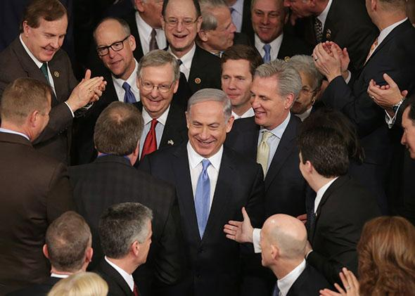 Israeli Prime Minister Benjamin Netanyahu is greeted by members of Congress as he arrives to speak during a joint meeting of the United States Congress.