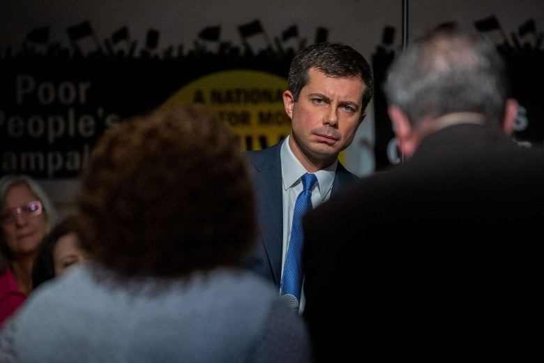 Buttigieg in the background, facing potential voters.