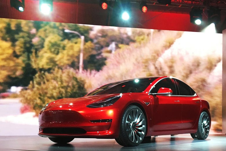 A Tesla Model 3 sedan, its first car aimed at the mass market, is displayed during its launch in Hawthorne, California, March 31, 2016.