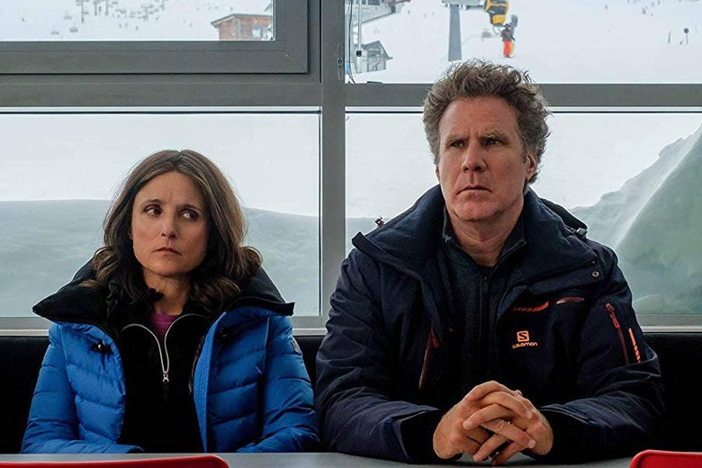 Julia Louis-Dreyfus and Will Ferrell, miserable, in parkas.