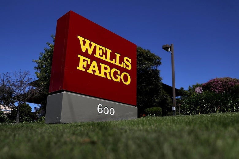 Sign displaying Wells Fargo logo outside the company's office.