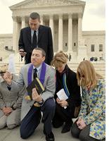 Pro-life advocates in prayer on the steps of the Supreme Court. Click image to expand.