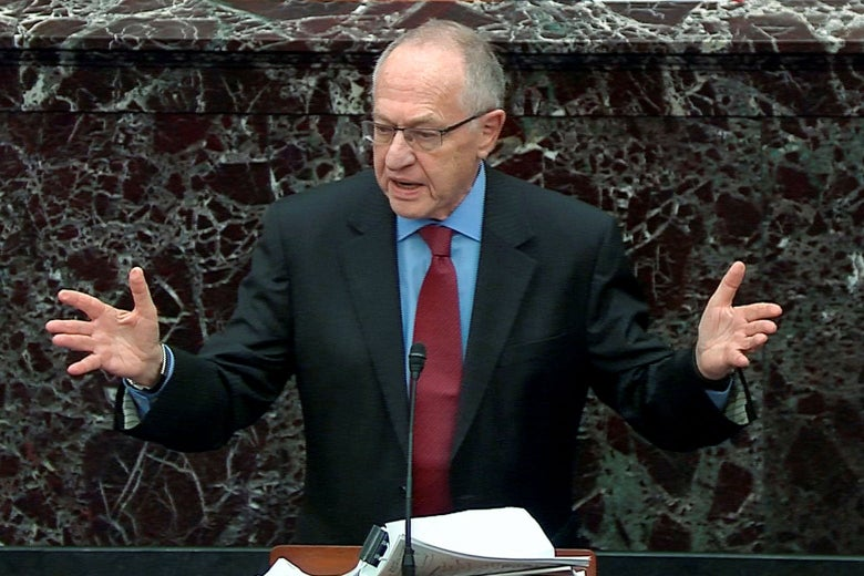 Dershowitz raises his arms while speaking at a mic before the Senate.