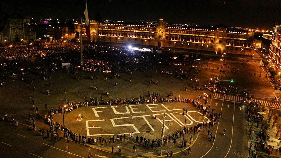 """Fue el estado"" (It was the state) painted on the Zócalo, or main square, Mexico City, October 2014."