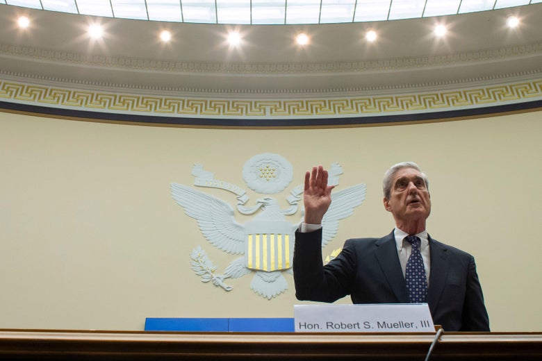 Robert Mueller stands, raising his right hand.