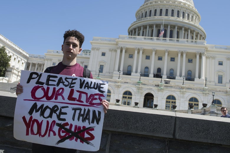 Amit Dadon, a graduate in 2017 from Marjory Stoneman Douglas High School, poses for a photo on the West Lawn of the US Capitol after rallying with several hundred fellow students to call for stricter gun laws in Washington, DC on April 20, 2018.