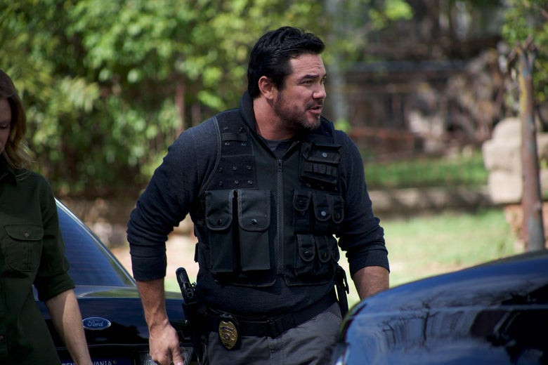 Dean Cain in a tactical police vest in a still from the movie.