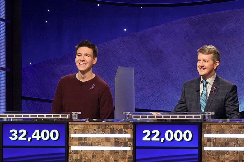 Holzhauer and Jennings smile from behind their podiums. Holzhauer has $32,400 on the board, and Jennings has $22,000.