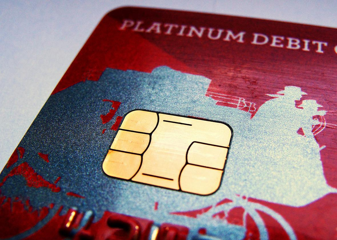 A computer chip is seen on newly issued debit/credit card in this photo illustration taken in Encinitas, California September 28, 2015.