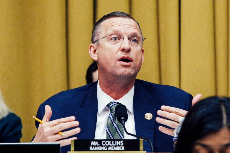 Doug Collins behind a name tag that says Mr. Collins, ranking member.