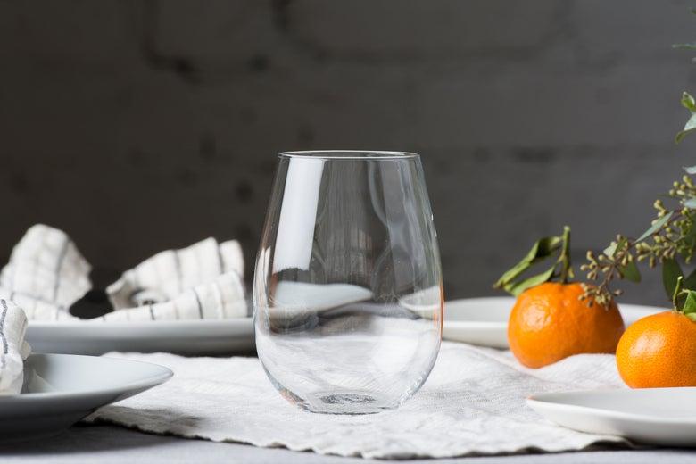 Ravenscroft Crystal Stemless Wine Glasses on a set table