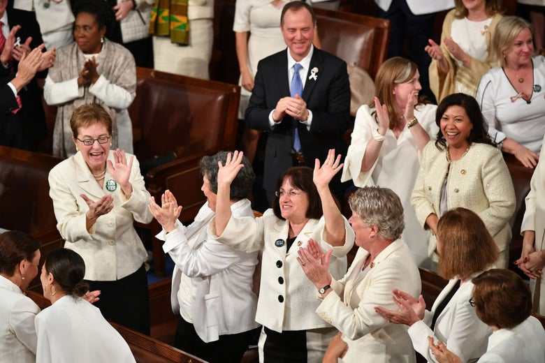 "Kuster ""raises the roof"" as other congresswomen dressed in white laugh and cheer."