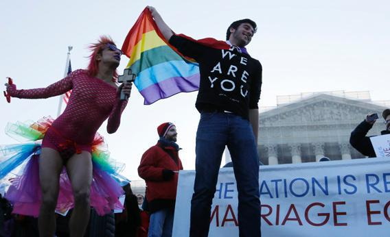 "A protester dressed as a devil who said his name is ""Queen"" stands with another demonstrator outside of the U.S. Supreme Court in Washington, March 26, 2013."