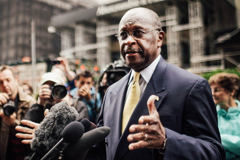 Herman Cain speaks to the media outside of Trump Tower before a scheduled appearance with real estate mogul Donald Trump on Oct. 3, 2011 in New York City.
