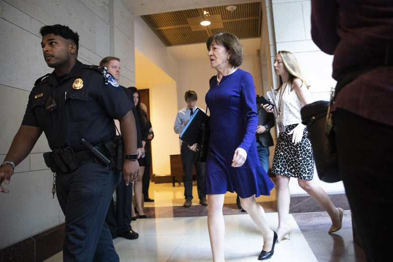 Collins walking behind a security guard.