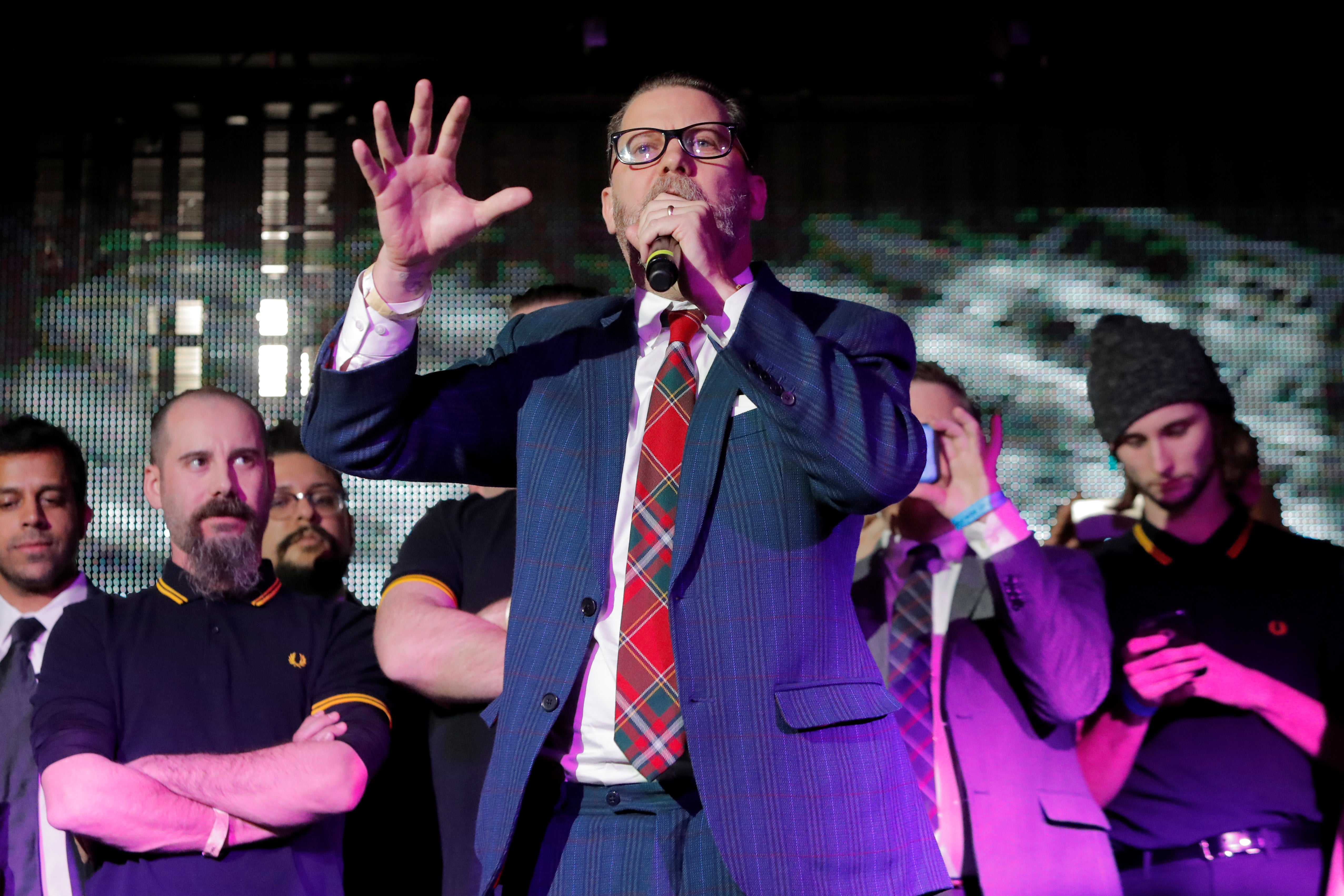 "Vice magazine co-founder Gavin McInnes speaks on stage with members of the Proud Boys organization at the ""A Night for Freedom"" event organized by Mike Cernovich in Manhattan on January 20, 2018."