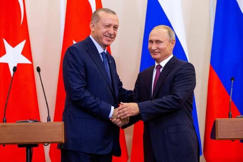 Russian President Vladimir Putin shakes hands with Turkish President Recep Tayyip Erdogan after their joint press conference following the talks, in the Bocharov Ruchei residence in the Black Sea resort of Sochi in Sochi on September 17, 2018.