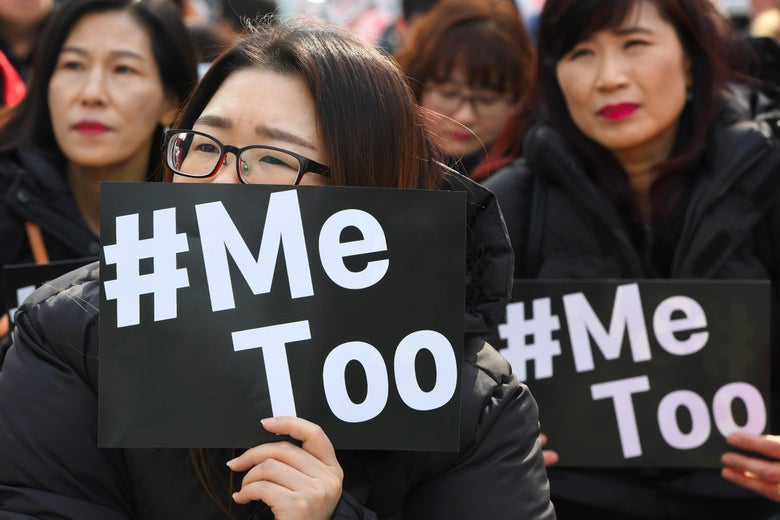 South Korean demonstrators hold banners saying #MeToo during a rally.