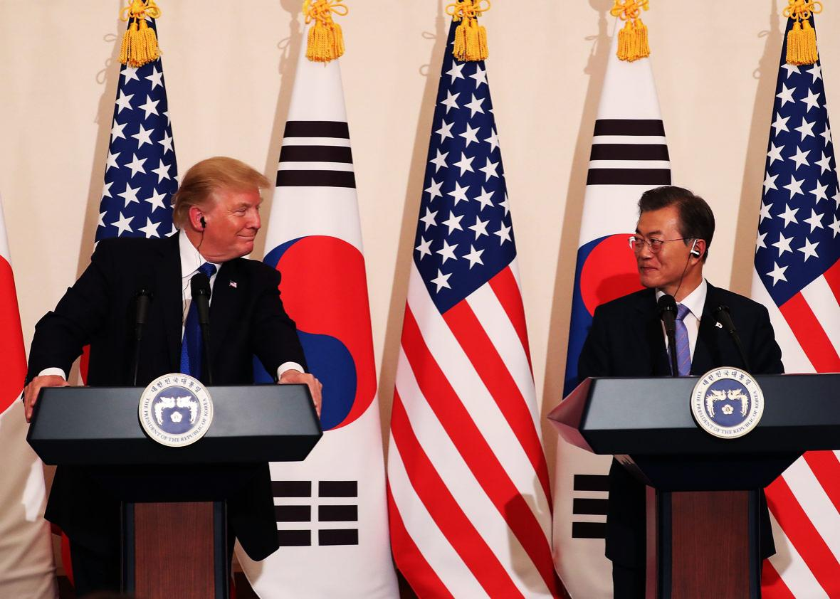 U.S. President Donald Trump talks with South Korean President Moon Jae-In