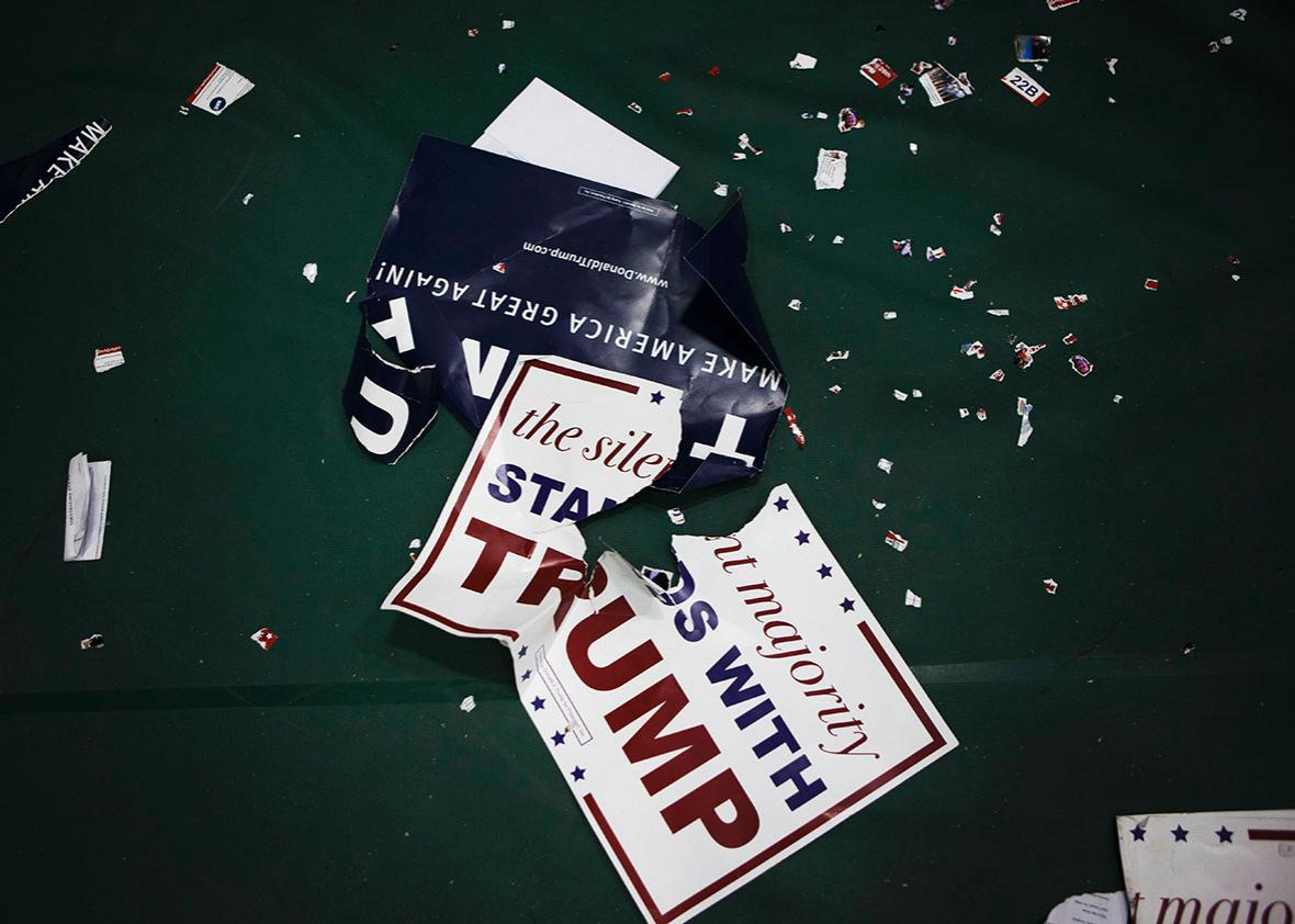 Torn posters litter the floor following a campaign rally with Republican presidential candidate Donald Trump on April 25, 2016 at West Chester University in West Chester, Pennsylvania.