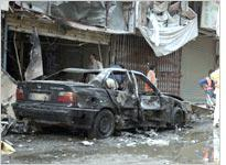 The site of a suicide attack in Baghdad. Click image to expand.