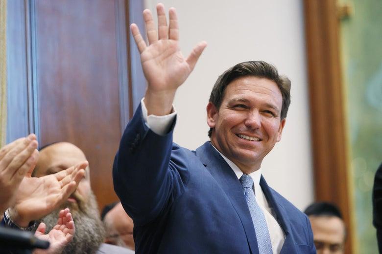 DeSantis smiling and waving