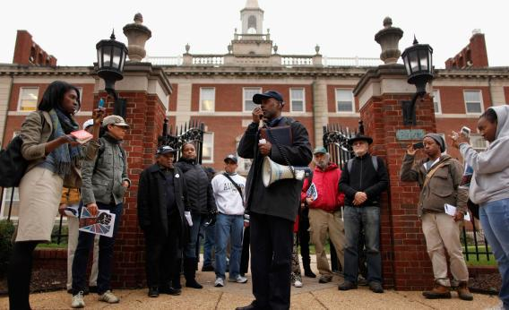 Organizer Talib Karim leads a rally of about 25 Howard University alumni, students, faculty, and supporters in front of Frederick Douglas Memorial Hall before marching downtown to show their support and solidarity with the Occupy Movement, Oct. 28, 2011, in Washington, D.C.