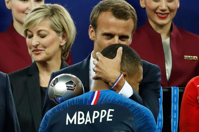 France's forward Kylian Mbappe receives the silver ball for best young player from French President Emmanuel Macron during the medals ceremony after the Russia 2018 World Cup final football match between France and Croatia at the Luzhniki Stadium in Moscow on July 15, 2018.