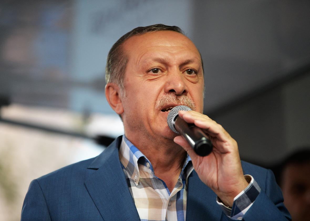 Turkish President Tayyip Erdogan delivers a speech to his supporters in Istanbul, July 16, 2016, Turkey.