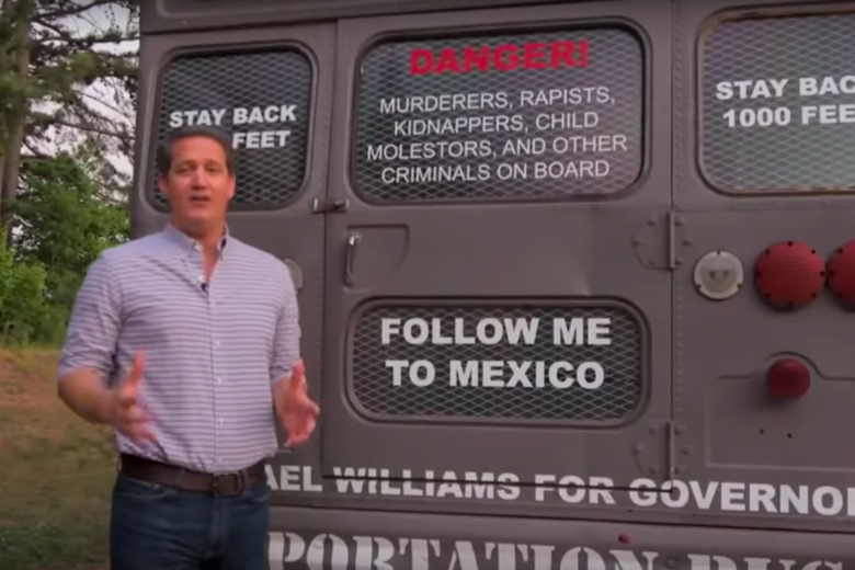 Michael Williams in front of the Deportation Bus