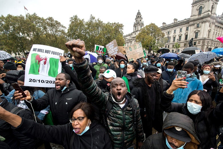 Protestors gather outside of Parliament as up to one thousand British Nigerians protest against corruptions and killings in Lagos in London.