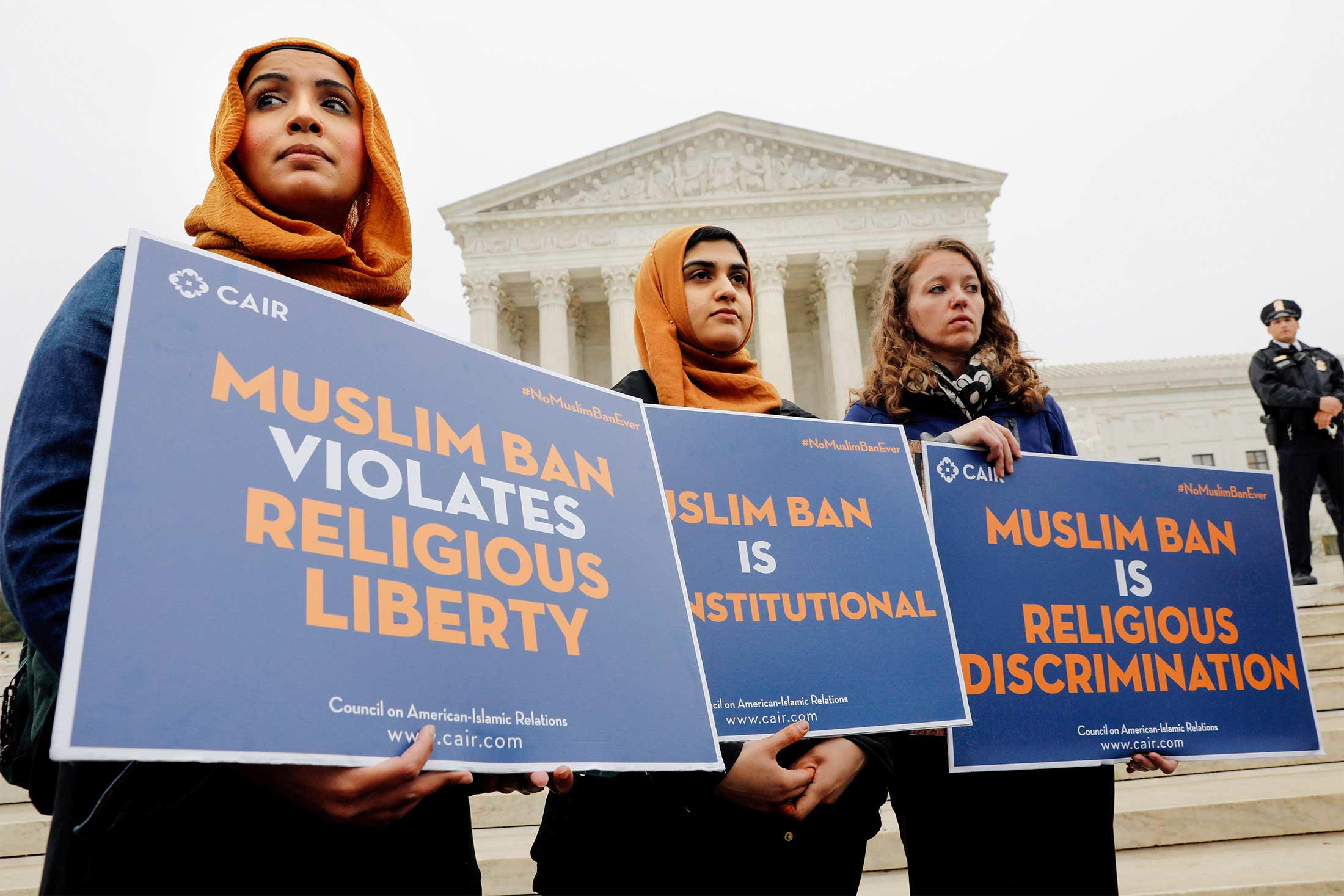Female protesters standing in front of the Supreme Court.