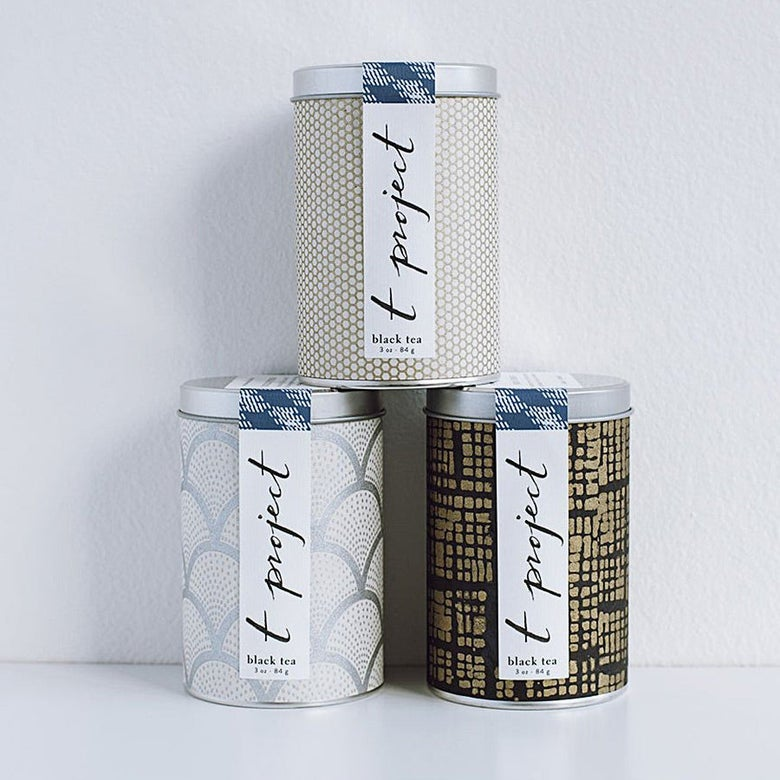 Three canisters of tea
