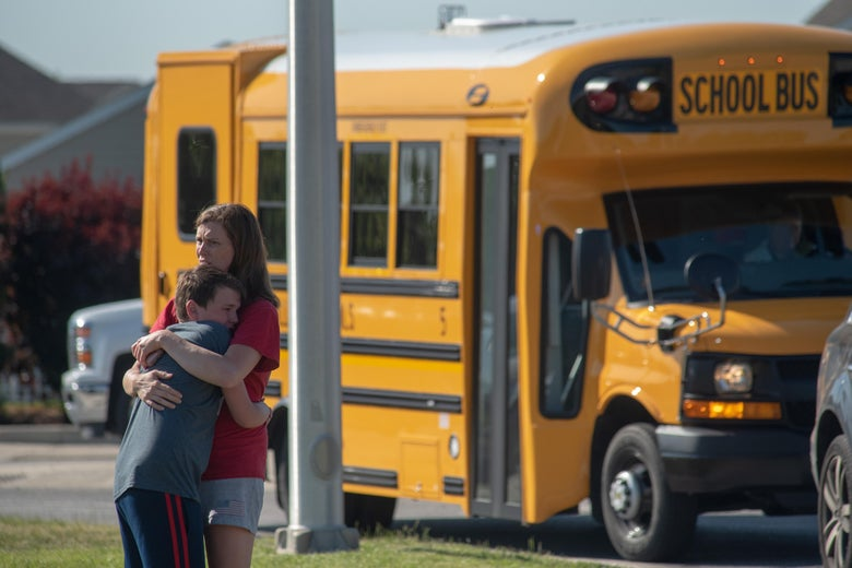 NOBLESVILLE, IN - MAY 25: A student and adult embrace outside Noblesville West Middle School after a shooting at the school on May 25, 2018 in Noblesville, Indiana. One teacher and one student were initially reported injured.  (Photo by Kevin Moloney/Getty Images)