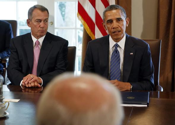 Speaker of the House John Boehner (L) listens to U.S. President Barack Obama at a meeting with bipartisan Congressional leaders in the Cabinet Room at the White House in Washington to discuss a military response to Syria, September 3, 2013.