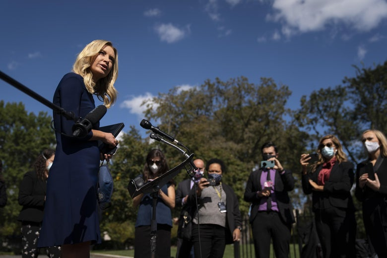 McEnany, maskless, speaking with masked reporters.