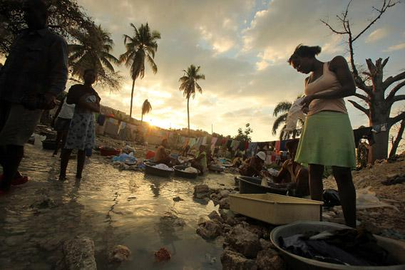 Haitians wash clothes in a stream January 8, 2011 in Port-au-Prince, Haiti.