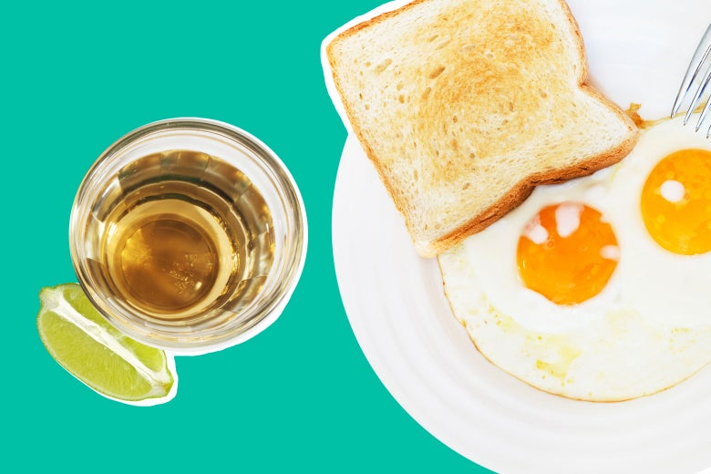 A shot of tequila alongside eggs and toast.