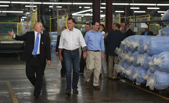 Mitt Romney and Wisconsin Governor Scott Walker walk with Dan Sinykin, president of Monterey Mills, as he gives them a tour of the factory on June 18, 2012 in Janesville, Wisconsin.
