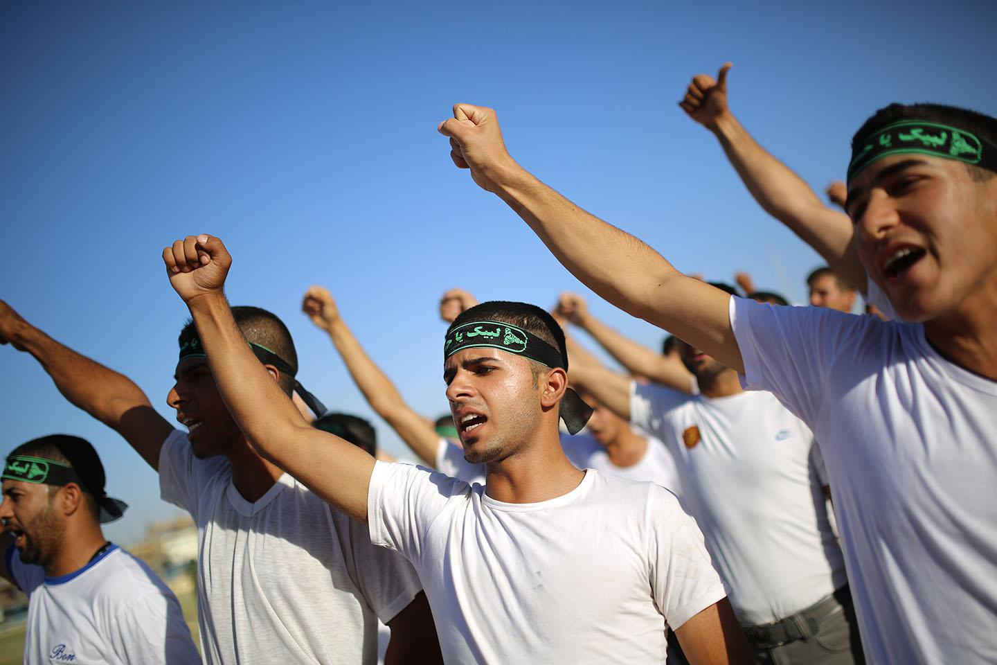 Shiite volunteers, who have joined the Iraqi army to fight against ISIS forces, participate in military-style training in Najaf, June 23, 2014.