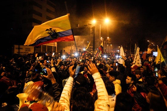 Demonstrators cheer in Quito, Ecuador.